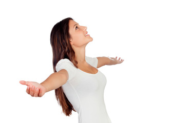 Young casual woman with arms outstretched symbolizing freedom