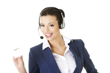 Beautiful smiling businesswoman with businesscard
