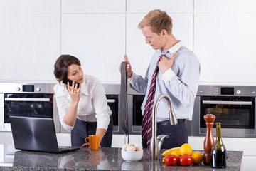 Woman choosing tie for her partner