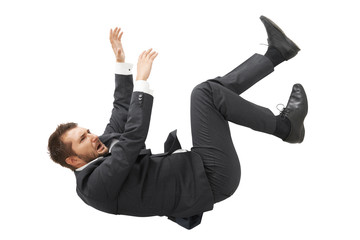 businessman in black suit falling down