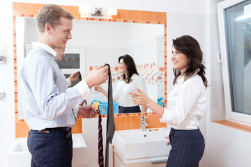 Young couple choosing a tie