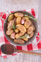 fried potato with garlic and rosemary