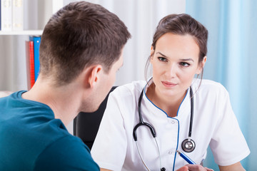 Man having medical consultation