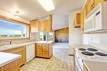 Countryside house interior. Kitchen room with vaulted ceilign an