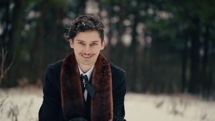 Happy Stylish Man Throws Up Snow