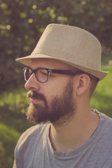 Bearded young hipster man daydreaming