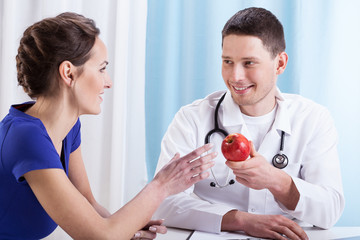 Doctor encouraging patient to health lifestyle