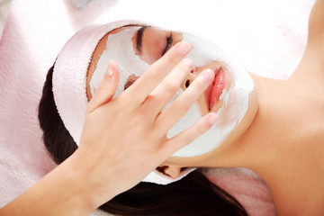 Relaxed woman with a nourishing face mask