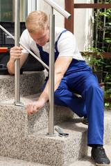 Man repairing a stair railing