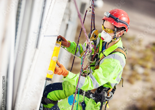 Industrial climber during construction works - 70372260