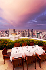 rooftop restaurant with cityscape background