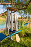A Wind chime isolated against a natural background. poster