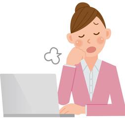 パソコンをする女性 ため息