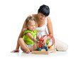 child girl and mother play with color educational toy