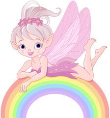 Pixie fairy on rainbow