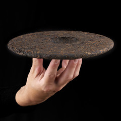 Woman's hand holding a frying pan.