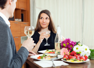 Young women having romantic dinner with her husband