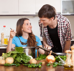 Guy and smile girl cooking