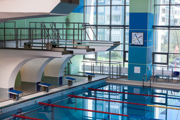 Diving boards into the water in the swimming pool