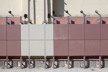 Installation of ventilated facades with tiles of building wall