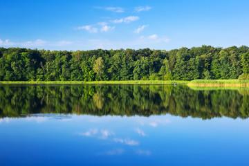 Masurian lake scenery with reflection, Poland
