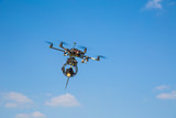 Multicopter in the sky poster