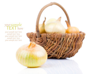 onion bulb in wicker basket, isolated on white background