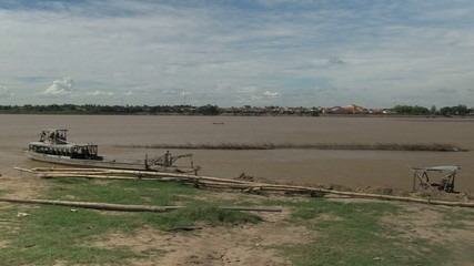 Old wood boat crossing the mekong river (5)