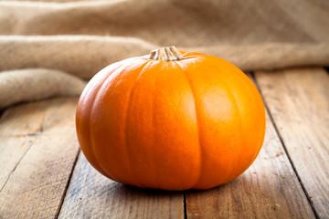 Autumn pumpkins on wooden board