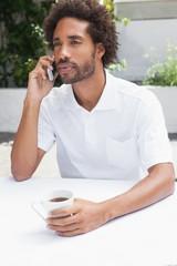 Man on the phone having coffee