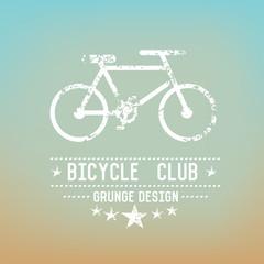 Bicycle badge grunge symbol on blur background