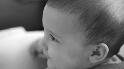 Baby with beautiful eyes looking at camera black and white