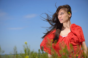 Outdoor portrait of attractive young woman enjoying nature