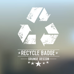 Recycle badge grunge symbol on blur background