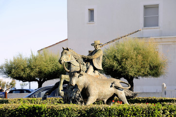 Statue of Guardian guiding a bull