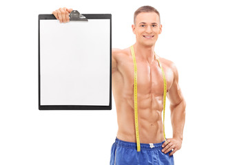 Shirtless male athlete holding a clipboard