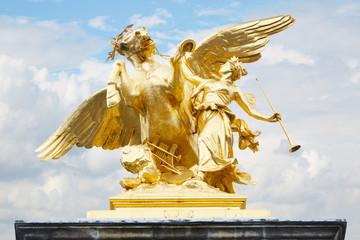 Alexandre III bridge golden statue in Paris