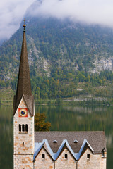 The Lutheran church and mountains overgrown with forests