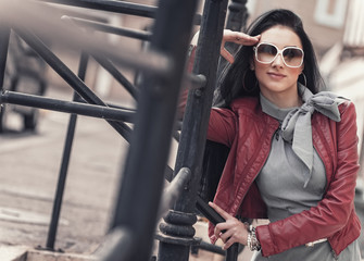 Fashion photo of a  woman with sunglasses posing