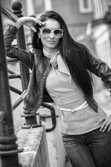 Trendy woman wearing sunglasses and posing