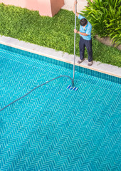 Worker cleaning the pool.