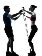 coach man woman exercising gymstick silhouette