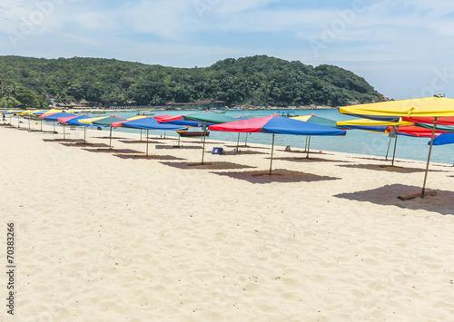 Leinwanddruck Bild Tropical beach with shade umbrella