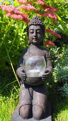 Knieender Buddha