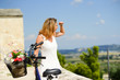 beautiful and attractive young woman sightseeing on bicycle