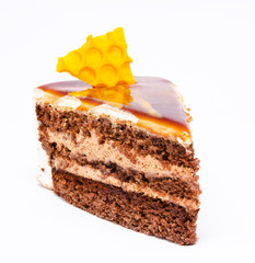 Piece of honey cake isolated on a white