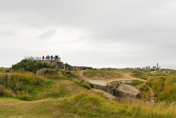 Tourists visiting German bunkers. Omaha beach, France.