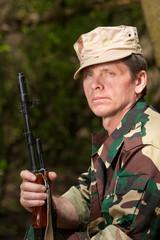 Portrait of hunter with gun