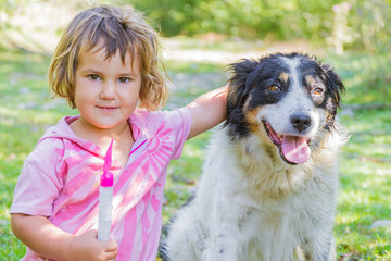 young pretty girl with dog outdoor portrait