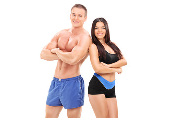 Sexy male and female athletes posing